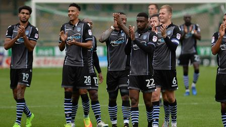 Colchester United players celebrate their 1-0 away win at Yeovil, at the end of September. Picture P