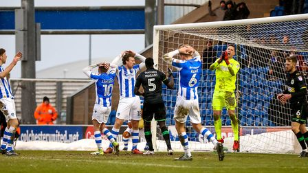 U's players react after Luke Prosser (left) had headed over the bar late on in yesterday's 1-0 defea