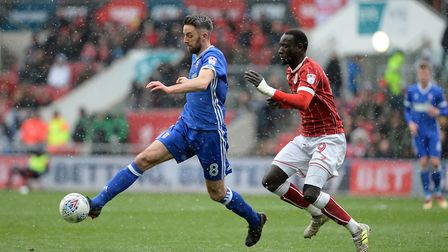 Cole Skuse gets the ball in the first half snow flurries at Ashton Gate Picture Pagepix