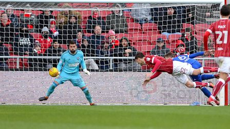 Milan Djuric scores the winner for Bristol City with a second half diving header Picture Pagepix