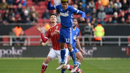 Jordan Spence wins a header at Bristol City Picture Pagepix