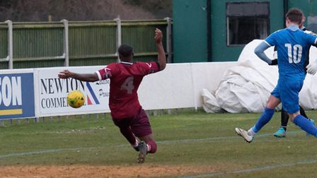 Christy Finch fires homes Jake Reed's cross for Leiston in their win over Wingate & Finchley. Pictur