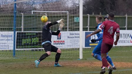 Jake Reed (hidden behind No 4) watches his shot enter the net for Leiston's fourth goal against Wing