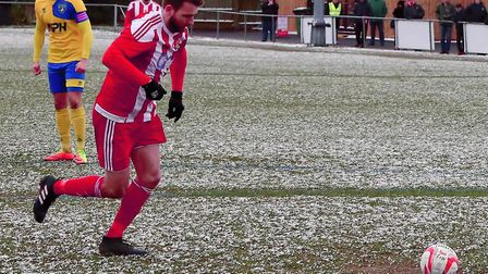 Joe Francis steps up to fire home the penalty to open the scoring for Felixstowe & Walton United in