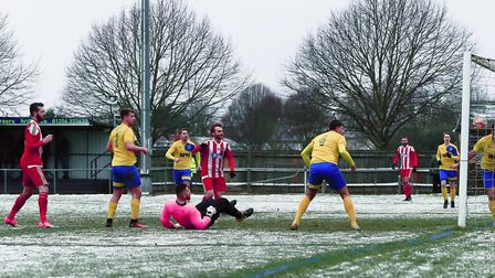 Felixstowe's Miles Powell (left) sees his goal bound shot cleared off the line by by Newmarket's Jac