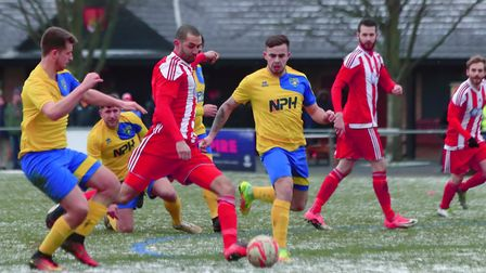 Felixstowe's Sheridan Driver shoots under pressure from Newmarket's Jacob Partridge. Picture: STAN B