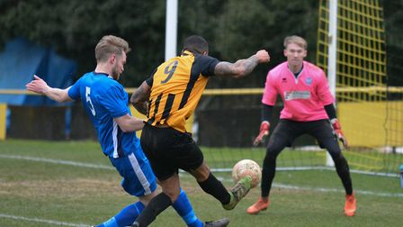 Remi Garrett fires in a shot for Stowmarket Town against Brantham. Picture: BEN POOLEY