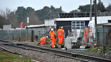 British Transport Police and Network Rail investigate the scene of collision on a level crossing off