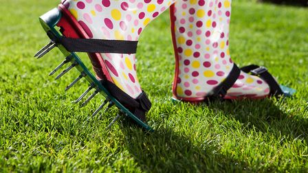 Spiked lawn shoes can help with lawn drainage. Picture:Thinkstock/PA.