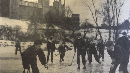 Although the thaw has begun, pupils from Framlingham College enjoy a game of ice-hockey on the Castl
