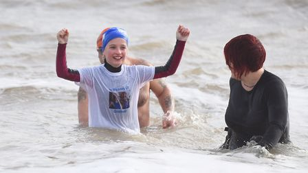 Ellie celebrates after striding out into the cold North Sea. Picture: GREGG BROWN