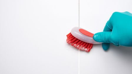 Get up close to clean bathroom tiles. See PA Feature HOMES Mould. Picture : Thinkstock/PA.