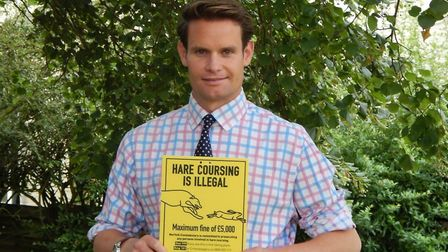 CLA East regional director Ben Underwood with an anti-hare coursing sign. Picture: CLA