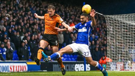 Carter-Vickers battles for the ball with the Wolves' Ryan Bennett. Picture: Steve Waller