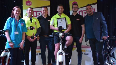 The team from Breheny with their yellow jersey alongside SJ Middleton from St Elizabeth Hospice and