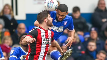 Town' Cameron Carter-Vickers in a battle with Sheffield United's Ched Evans at Portman Road. Pictur