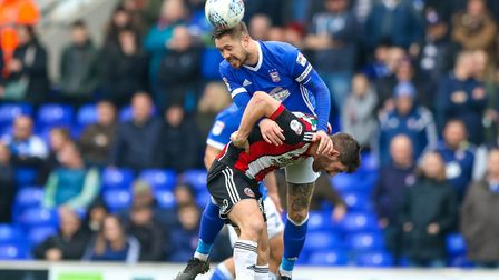 Ipswich Town skipper Luke Chambers wins this battle with Sheffield United striker Ched Evans. Photo: