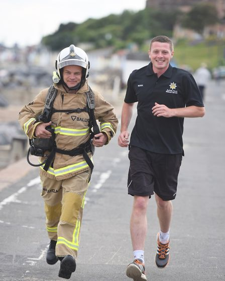 Suffolk firefighter Dale Mason with colleague Ed Trevaskis. Picture: GREGG BROWN