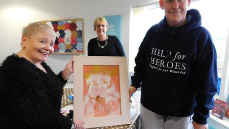 Annie Fennymore with her art work and veterans at the Colchester recovery centre. Picture: ANN SCOTT