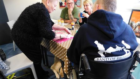 Annie showing Colchester veterans her unique approach to art. Picture: ANN SCOTT/HELP FOR HEROES