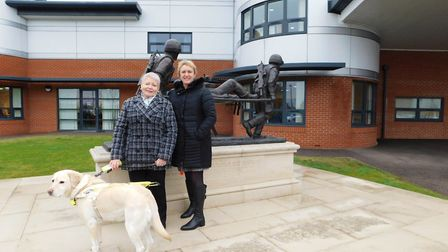 Annie, who began to have blurry vision at the age of 28, pictured with her guide dog Mary outside Co