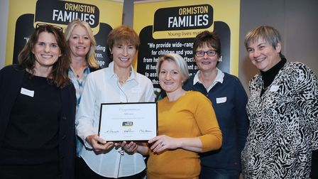 Ormiston Families' Mpower team receiving their Team of the Year award from donor Eileen Schlee. Pi