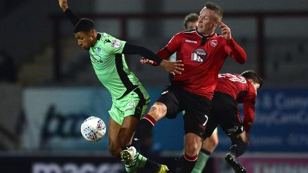 Brandon Comley, left, battles with Garry Thompson during the first half at Morecambe. Picture: RICHA