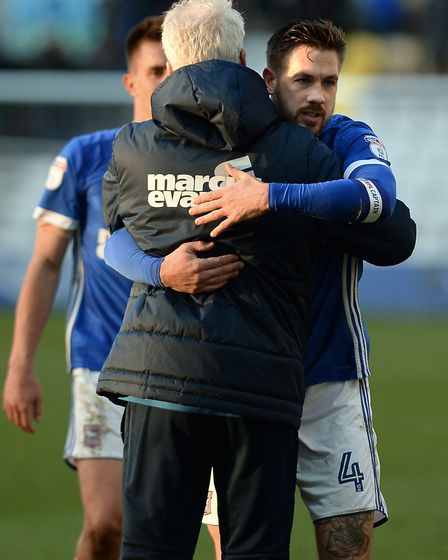 Mick McCarthy gets a hug from his captain Luke Chambers after Saturday's win at Preston. Photo: Page