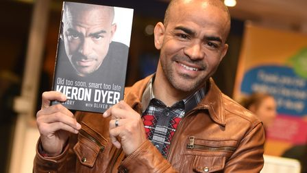 Kieron Dyer shows off his autobiography at last week's launch. Picture: GREGG BROWN