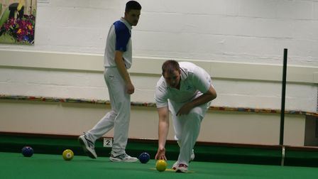 Action from the final of the Risbygate Masters Tournament: Wayne Willgress in action watched by the