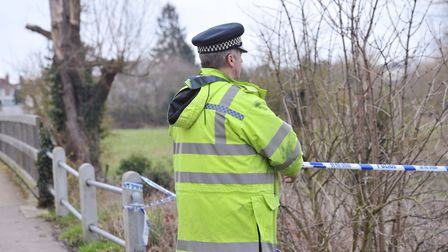 Police investigate the scene where a body was found in the River Brain in Whitham. Picture: SARAH L