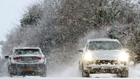 Cars in the snow. Picture: Gareth Fuller/PA Wire