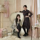 Pearl (right) and Daisy in Pearl Lowe's bedroom with pink faux silk Clarence Chemise curtains, with