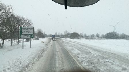The A140 this morning is one of a number of routes affected by snow. Picture: ELLIOTT BROWN