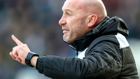 Colchester United boss, John McGreal, pictured during the U's last outing, a 1-0 home defeat to Barn