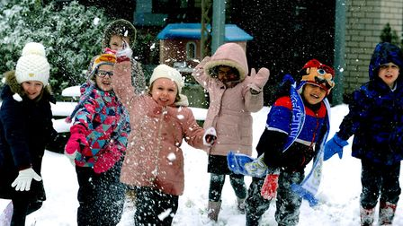 Snow business: Pupils at Hardwick Primary School in Bury St Edmunds celebrate the school open and ha