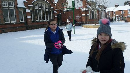 Pupils enjoying the snow at Clifford Road Primary School in Ipswich. Mia and Natalia. Picture: CLIFF