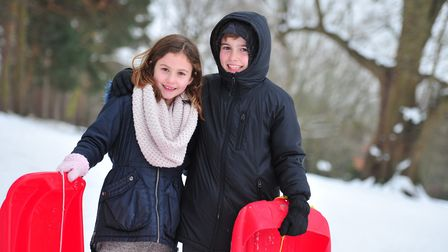 Betty and Sid going sledging after school. Picture: SARAH LUCY BROWN
