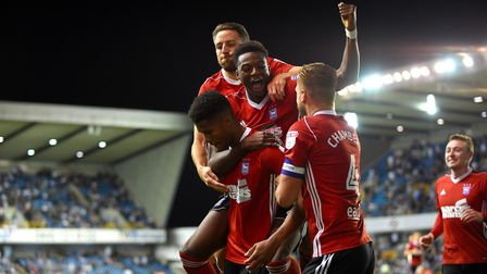 Town players celebrate Jordan Spence's late winner at Millwall. Photo: Pagepix