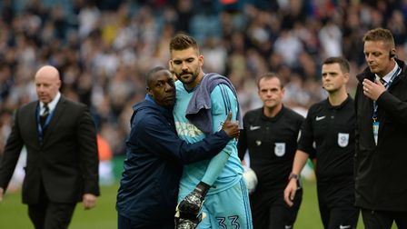 Terry Connor tries to console a disappointed Bartosz Bialkowski after his costly error in the 3-2 de