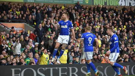 Luke Chambers jumps to celebrate after scoring a late goal at Carrow Road. Photo: Pagepix