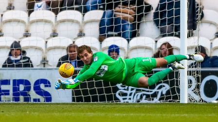 U's keeper Sam Walker, at full stretch to make a save during the 3-1 home win over Exeter in Decembe