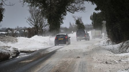 Police have urged people to head home from work early because of poor road conditions and the threat