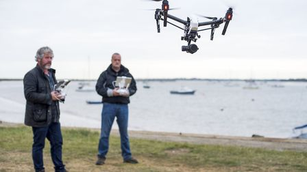 Film-maker Tim Curtis sending one of his camera drones aloft to get sweeping views of the river Debe