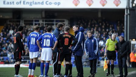 Ipswich v Middlesbrough, 2012. Players and officials discuss the state of the surface just before