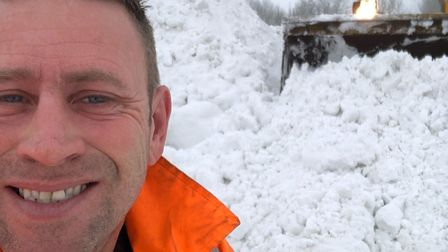 Snow Hero Chris Askew snaps a selfie while working hard to help the community. Picture: CHRIS ASKEW