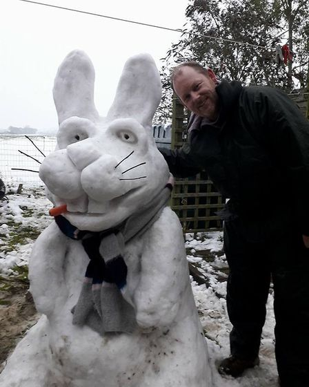 Roger Goodchild with his snow bunny in Worlingworth. Picture: ROGER GOODCHILD