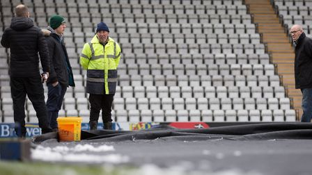 Match off: the pitch inspection at Morecambe's Globe Arena on Friday lunchtime, which led to Saturda