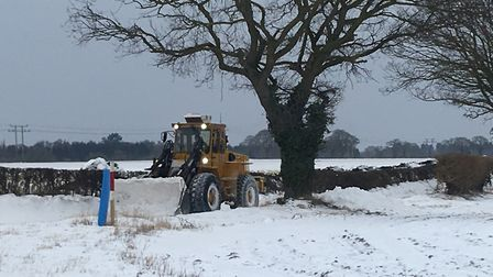 Richard Welham was out clearing roads blocked by snow in Newbourne. Picture: DAMON JONES