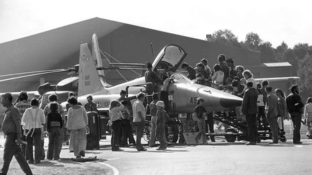 Visitors queue to see the cockpit of an F-5